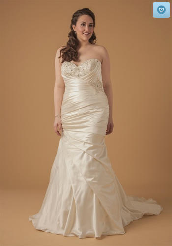 We love this mermaid gown by Dina Davos! Visit theknot.com or kleinfeldbridal.com for more information!